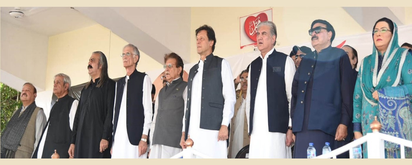 Muzaffarabad: PM Pakistan Imran Khan, Raja Muhammad Farooq Haider Khan and national leadership standing while listening to the national anthem.