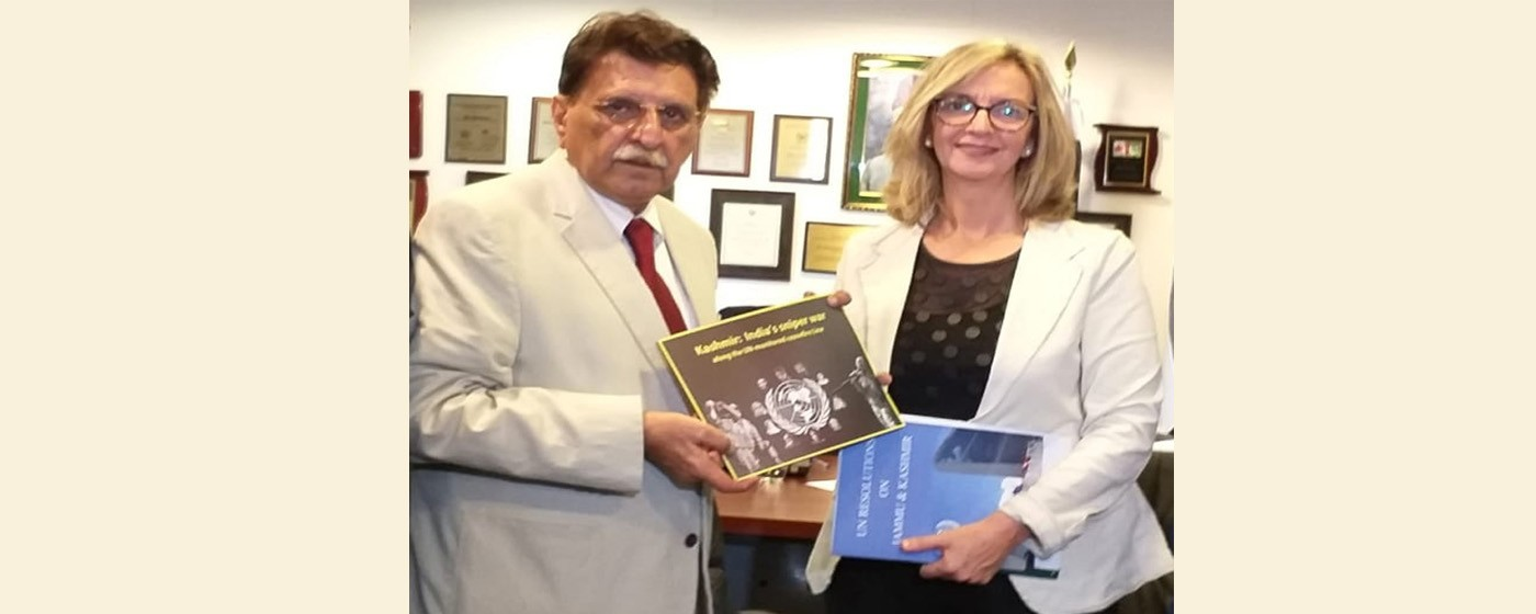 Barcelona: PM AJ&K Raja Muhammad Farooq Haider Khan presents a report to Merce Pereu a member national parliament of Spain on brutal victimization of innocent Kashmiries by Indian Army in Indian held Kashmir.